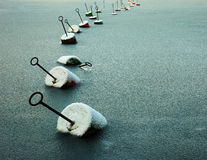 Chain of buoys at frozen sea Royalty Free Stock Photography