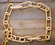 Chain Carved from One Piece of Wood on Wood Royalty Free Stock Photo