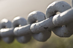 Chain close-up. Old rusty chain close-up (selective focus royalty free stock image