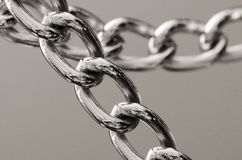Chain. Close up of chain against a plain background Royalty Free Stock Image