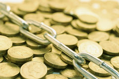 Chain and Coins. In Warm Tone Royalty Free Stock Image