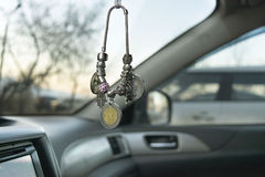 Chain of coins and beads in car, close, selective focus Stock Photo