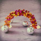 Chain of colored balls. And two hole with light.Rendered in 3d royalty free stock photos