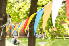 Chain of colored flags on the lawn Stock Photo