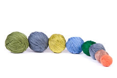 Chain of colorful clews for knitting Stock Images