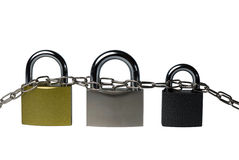 Chain, connecting three padlocks Royalty Free Stock Photo