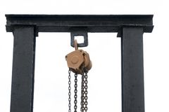 Chain and crane with black iron pole against white background. royalty free stock photos