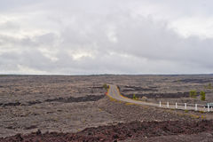Chain of craters road in Big Island of Hawaii. Solidified Cracked Lava Flow in Volcano, volcanic landscape when driving Chain of craters road in Big Island of Royalty Free Stock Photography