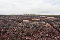 Chain of craters road in Big Island of Hawaii. Solidified Cracked Lava Flow in Volcano, volcanic landscape when driving Chain of craters road in Big Island of Royalty Free Stock Photos