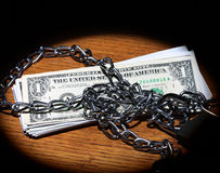 Chain and dollar bills Royalty Free Stock Images