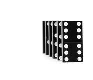 Chain of dominoes Stock Images