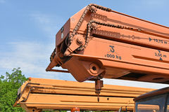 Chain drive of an old mobile crane vehicle Stock Photo