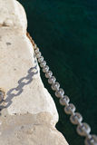 Chain at the edge Stock Images