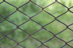 Chain Fence. A closeup of a chain fence Stock Images