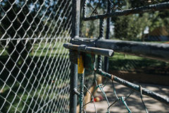 Chain fence gate. Old rusty chain fence gate with lock open Stock Photography