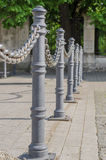 Chain fence and poles closeup Royalty Free Stock Image