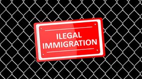 Chain fence with red sign Illegal Immigration Royalty Free Stock Photography