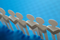 Chain of figures. Horizontal image of paper figures Royalty Free Stock Images