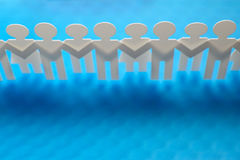 Chain of figures. Horizontal image of paper figures Stock Images