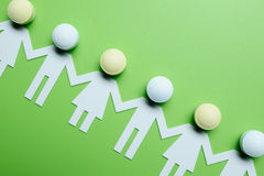 Chain of figures. Green background Stock Image