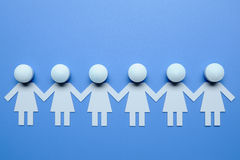 Chain of figures. On blue background Stock Photography