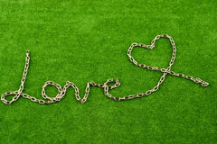 Chain form a heart shape and the word LOVE Royalty Free Stock Images