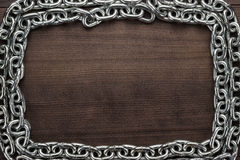 Chain frame on the wooden background Stock Photos