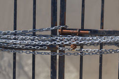 A chain on a gate preventing access Royalty Free Stock Images