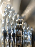 Chain and gears in bright light Stock Photos
