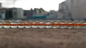 A chain of glass balls... Royalty Free Stock Photo