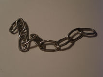 Chain. The chain on gray background Royalty Free Stock Photos