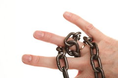 Chain on hand and wedding Ring. Isolated chain on woman hand and wedding Ring Royalty Free Stock Photo