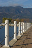 Chain handrails. White chain handrails along lakeshore with mountain view Stock Photos