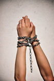 Chain hands slavery. Chained hands of female prisoner, lack of freedom Royalty Free Stock Photo