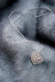 Chain with heart on fur. Elegant chain with diamond heart on fur Stock Photography