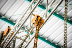 Chain hoist. S are hung on the steel frame royalty free stock photography