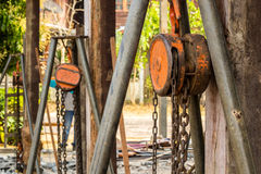 Chain hoist with a large wooden pole. Royalty Free Stock Photo