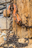 Chain hoist with a large wooden pole. Stock Photo
