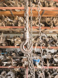 Chain and hook in garage Royalty Free Stock Photos