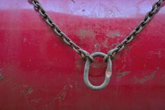 Chain and interlock. On a metal red surface Royalty Free Stock Images