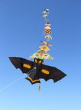Chain of kites on blue sky background Stock Image