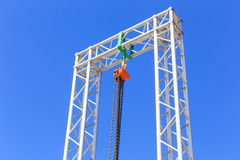 Chain lift on blue sky Royalty Free Stock Photos