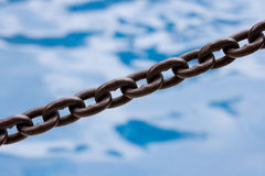 Chain link. On blurred background. Shallow depth of field Stock Photos