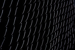 Chain Link Abstract. High-contrast, shallow depth of field image of chain link fence stock image