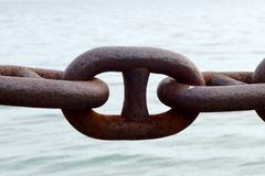 Chain link against water Stock Photos