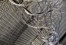 Chain link barb razor wire security fence closeup Stock Photo