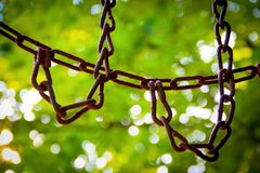 Chain link. In colorful bokeh background royalty free stock image