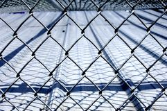 Chain Link Fence. Over roof with diamond designs Royalty Free Stock Photography