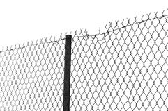 Chain link fence. Barbed wire chain link fence. Black and white stock photography