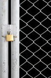 Chain link fence. And metal door with lock isolated on black royalty free stock photos